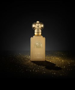 A gold luxurious perfume bottle made by Clive Christian for women