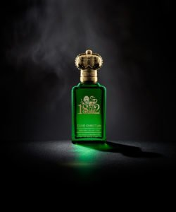 Clive Christian's luxury perfume comes in a green bottle with a golden lid shaped as a crown