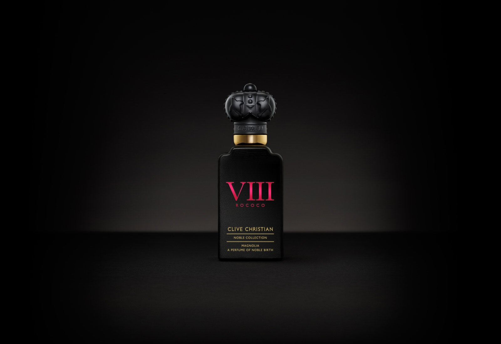Clive Christian's luxury perfume VIII Magnolia comes in a black bottle with red writing